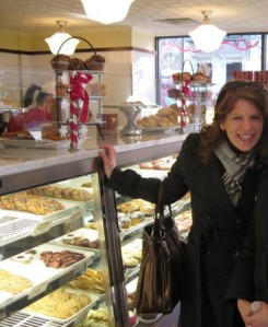 Me (and my sis's hand) w/ the goodies at Crumbs.