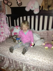 "Sitting pretty in her new big girl ""bed"" (converted crib to toddler bed ... a step we thought we could bypass!)"