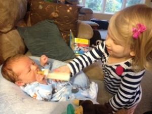 She feeds him.
